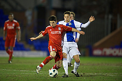 BIRKHENHEAD, ENGLAND - Monday, February 28, 2011: Liverpool's Daniel Pacheco and Blackburn Rovers' Thomas Hitchcock during the FA Premiership Reserves League (Northern Division) match at Prenton Park. (Photo by David Rawcliffe/Propaganda)