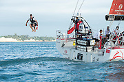 The Volvo Ocean Race fleet start leg 5 in the Waitamata Harbour Auckland bound for Itajai, Brazil. Emirates Team New Zealand sailor Peter Burling jumps off the back of Dongfeng Race Team. 18/3/2015