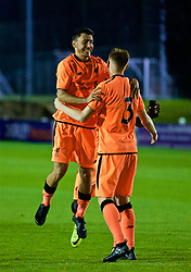 LEYLAND, ENGLAND - Friday, September 1, 2017: Liverpool's George Johnston [#3] celebrates with Yan Dhanda after scoring the winning penalty in the shoot-out during the Lancashire Senior Cup Final match between Fleetwood Town and Liverpool Under-23's at the County Ground. (Pic by Propaganda)