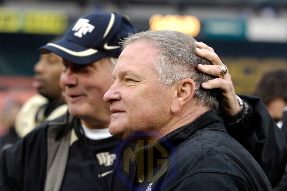 20 December 2008: Wake Forest head coach Jim Grobe gets a pat on the head from Bill Faircloth - Assistant Athletic Director following the Wake Forest University Demon Deacons win over the Naval Academy Midshipmen 29-19 in the inaugural EagleBank Bowl in Washington, D.C