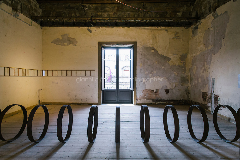 PALERMO, ITALY - 15 JUNE 2018: &quot;Steel Rings&quot; (2013) and &quot;Letterhead&quot; (1950-2013) by artist Rayyane Tabet are seen here at Palazzo Ajutamicristo during Manifesta 12, the European nomadic art biennal, in Palermo, Italy, on June 15th 2018.<br /> <br /> Manifesta is the European Nomadic Biennial, held in a different host city every two years. It is a major international art event, attracting visitors from all over the world. Manifesta was founded in Amsterdam in the early 1990s as a European biennial of contemporary art striving to enhance artistic and cultural exchanges after the end of Cold War. In the next decade, Manifesta will focus on evolving from an art exhibition into an interdisciplinary platform for social change, introducing holistic urban research and legacy-oriented programming as the core of its model.<br /> Manifesta is still run by its original founder, Dutch historian Hedwig Fijen, and managed by a permanent team of international specialists.<br /> <br /> The City of Palermo was important for Manifesta&rsquo;s selection board for its representation of two important themes that identify contemporary Europe: migration and climate change and how these issues impact our cities.
