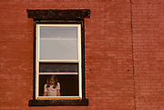 Lone Girl in Window, New York City, New York, USA, May 1982