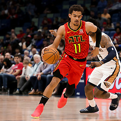 Mar 26, 2019; New Orleans, LA, USA; Atlanta Hawks guard Trae Young (11) drives past New Orleans Pelicans guard Elfrid Payton (4) during the first quarter at the Smoothie King Center. Mandatory Credit: Derick E. Hingle-USA TODAY Sports