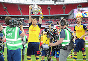 Arsenal's Olivier Giroud with the Cup during the The FA Cup match between Arsenal and Aston Villa at Wembley Stadium, London, England on 30 May 2015. Photo by Phil Duncan.
