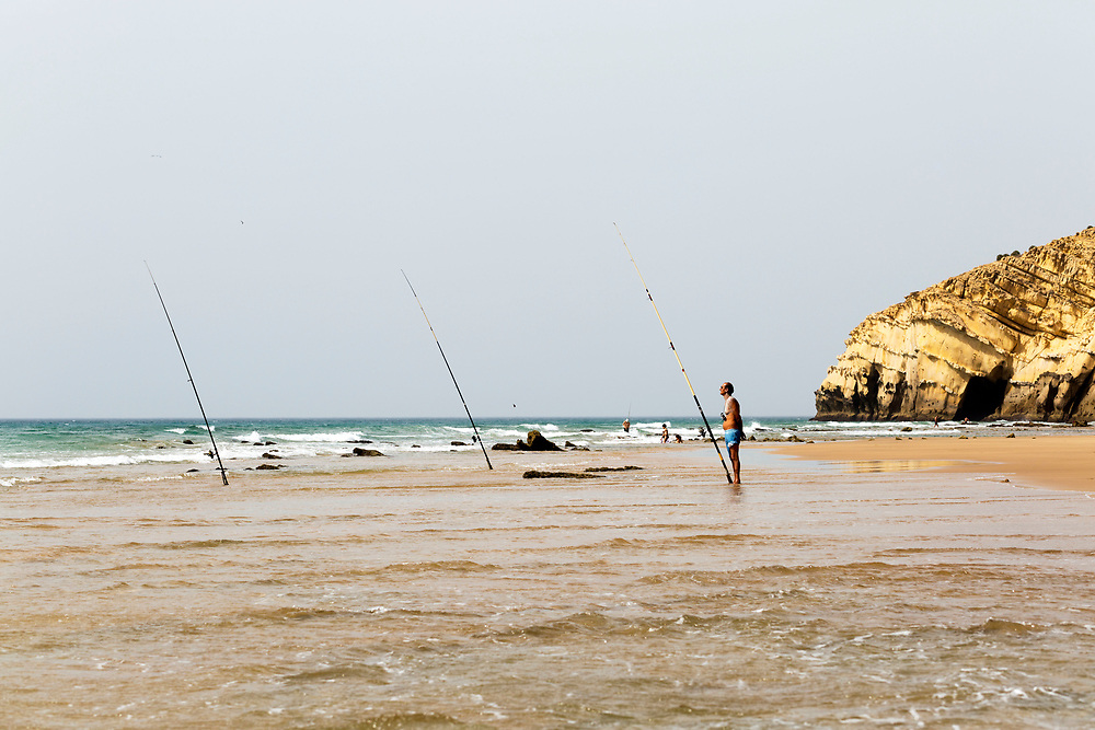 Tourists fishing at the Paradise Beach, Asilah, Morocco, 2015-08-09. <br />
