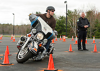 Laconia Patrolman Robb Sedgley practices his driving skills with Alton Patrolman Sean Sullivan at the Police Motorcycle Driving Course Wednesday afternoon at the Laconia Airport.  (Karen Bobotas/for the Laconia Daily Sun)