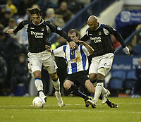 Photo: Aidan Ellis.<br /> Sheffield Wednesday v Manchester City. The FA Cup. 07/01/2007.<br /> Wednesday's Glenn Whelan is out Muscled by City's Georgios Samaras and Ousmane Dabo (R)