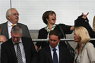 Norwich City's Joint Majority Shareholder Delia Smith points out the sea of yellow from the traveling Norwich fans to her husband before the Barclays Premier League match at the DW Stadium, Wigan...Picture by Paul Chesterton/Focus Images Ltd. .07904 640267.13/8/11