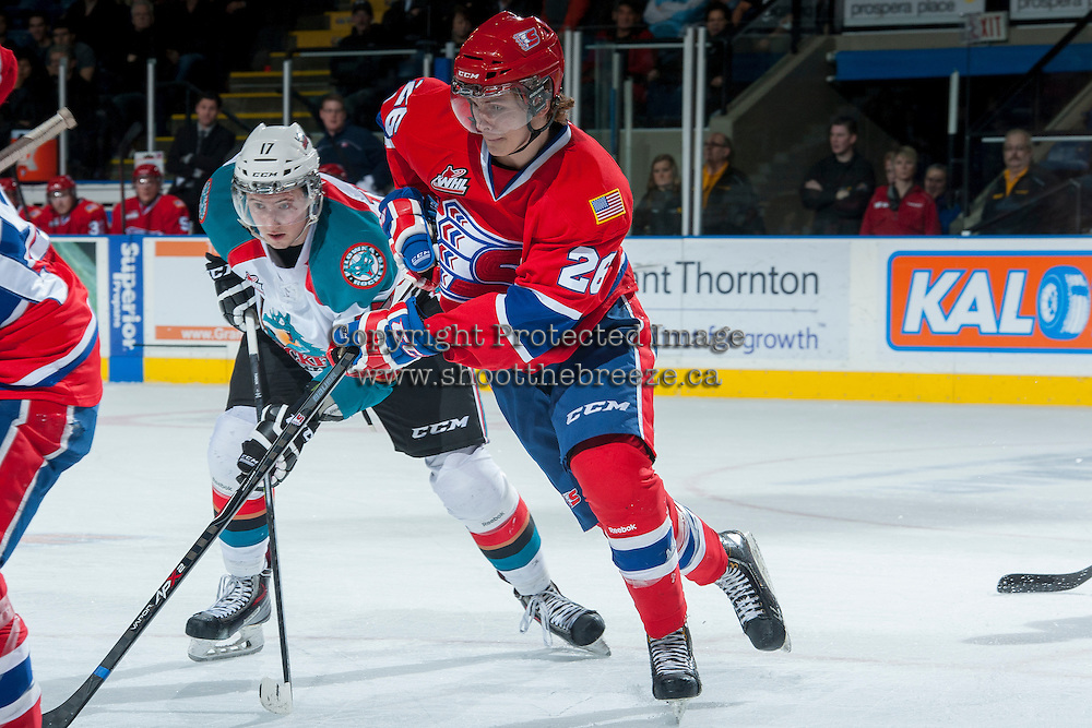 KELOWNA, CANADA -JANUARY 29: Hudson Elynuik LW #26 of the Spokane Chiefs is checked by Marek Tvrdon #17 of the Kelowna Rockets during first period on January 29, 2014 at Prospera Place in Kelowna, British Columbia, Canada.   (Photo by Marissa Baecker/Getty Images)  *** Local Caption *** Hudson Elynuik; Marek Tvrdon;