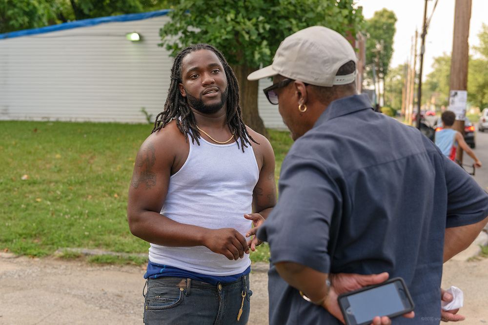 Eddie Woods, director of Street Peace: No More Red Dots, talks with Markell Carter Monday, June 20, 2016 near Whitey's Grocery in the Parkland neighborhood. (Photo by Brian Bohannon)