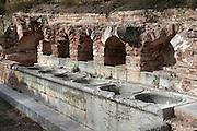 Marble basins used to wash the laundry , Cartoixa d'Escaladei (Carthusian Monastery of Santa Maria d'Escaladei), 1194, Escaladei, at the foot of the Montsant range, Priorat, Tarragona, Spain. Cartoixa d'Escaladei was the first Carthusian monastery in the Iberian peninsula. Picture by Manuel Cohen