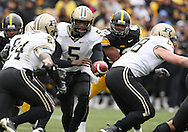 15 NOVEMBER 2008: Purdue quarterback Justin Siller (5) hands the ball off to Purdue running back Kory Sheets (24) in the second half of an NCAA college football game against Purdue, at Kinnick Stadium in Iowa City, Iowa on Saturday Nov. 15, 2008. Iowa beat Purdue 22-17.