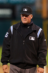 May 17, 2011; Oakland, CA, USA; MLB umpire Ted Barrett (65) stands behind home plate before the game between the Oakland Athletics and the Los Angeles Angels at Oakland-Alameda County Coliseum. Oakland defeated Los Angeles 14-0.