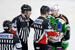 Ales Music (HDD Tilia Olimpija, #16) talking to referees during ice-hockey match between HDD Tilia Olimpija and SAPA Fehervar AV19 at fourth match in Quarterfinal  of EBEL league, on Februar 26, 2012 at Hala Tivoli, Ljubljana, Slovenia. HDD Tilia Olimpija won 6:4. (Photo By Matic Klansek Velej / Sportida)