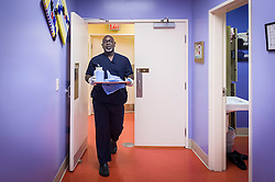 Dr. Willie Parker, exits a procedure room, after completing an abortion at the Jackson Women's Health Organization clinic, on Tuesday August 19, 2014, in Jackson, Mississippi. This is the only clinic in the entire state that performs abortions. (Photo © Jock Fistick)