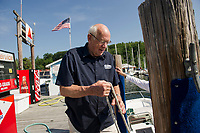 Merrill Fay assists a boater at the gas dock at Fay's Boat Yard.  (Karen Bobotas/for New England Boating).
