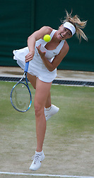 25.06.2011, Wimbledon, London, GBR, Wimbledon Tennis Championships, im Bild Maria Sharapova (RUS) in action during the Ladies' Singles 3rd Round match on day six of the Wimbledon Lawn Tennis Championships at the All England Lawn Tennis and Croquet Club, EXPA Pictures © 2011, PhotoCredit: EXPA/ Propaganda/ *** ATTENTION *** UK OUT!
