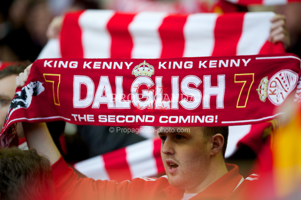 LIVERPOOL, ENGLAND - Saturday, February 19, 2012: Liverpool supporters with a King Kenny Dalglish scarf during the FA Cup 5th Round match against Brighton & Hove Albion at Anfield. (Pic by David Rawcliffe/Propaganda)