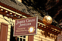 A store sign of a jeweler and  watch-maker  in the historic old town of  Williamsburg Virginia.