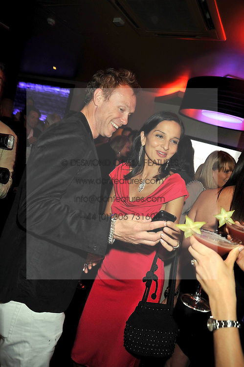 GARY KEMP and YASMIN MILLS at a party to celebrate the new Stephen Webster store on Mount Street, London W1 followed by a dinner at Maddox, Mill Street, London on 24th June 2009.