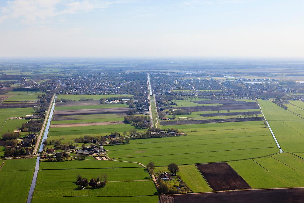 Nederland, Overijssel, Dedemsvaart, 01-05-2013; overzicht vanuit het Westen met<br /> zicht op de Hoofdvaart, rechts van het midden (water deels gedempd, met knik). Voormalige veenkolonie.<br /> Main canal of former peatland 'colony'.<br /> luchtfoto (toeslag op standard tarieven);<br /> aerial photo (additional fee required);<br /> copyright foto/photo Siebe Swart