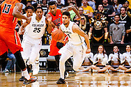 January 2nd, 2014:  Colorado Buffaloes junior guard Askia Booker (0) rushes the ball up the court in the second half of action in the NCAA Basketball game between the Oregon State Beavers and the University of Colorado Buffaloes at the Coors Events Center in Boulder, Colorado