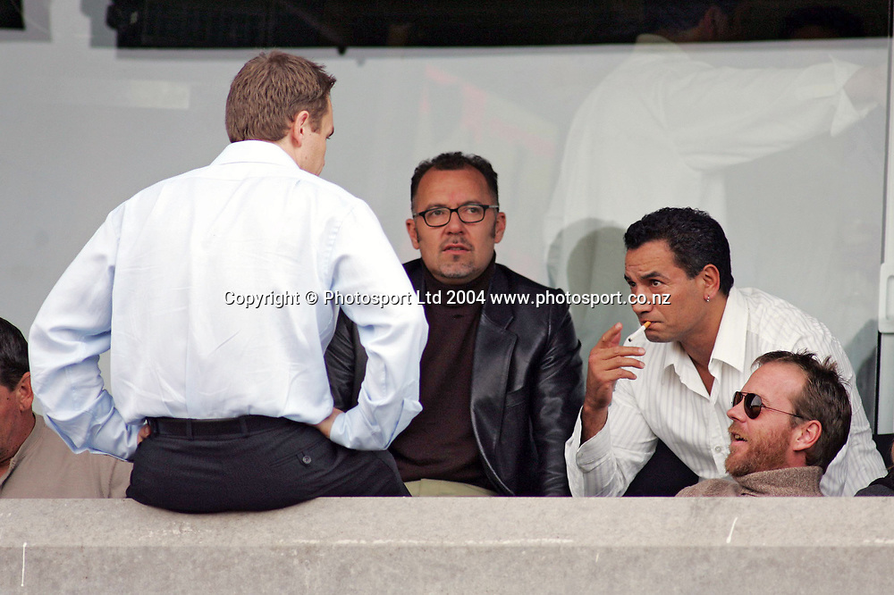 Celebrities Peter Urlich, Temuera Morrison and Keifer Sutherland watch from the stands during the NRL match between the North Queensland Cowboys and the New Zealand Warriors at Ericsson Stadium, Auckland, New Zealand, on Sunday 20 June, 2004. <br /> The Warriors were defeated 28-26<br /> Copyright photo: www.photosport.co.nz