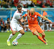 Arjen Robben (right) of Netherlands and Michael Umana of Costa Rica during the 2014 FIFA World Cup match at the Itaipava Arena Fonte Nova, Nazare, Bahia<br /> Picture by Stefano Gnech/Focus Images Ltd +39 333 1641678<br /> 05/07/2014