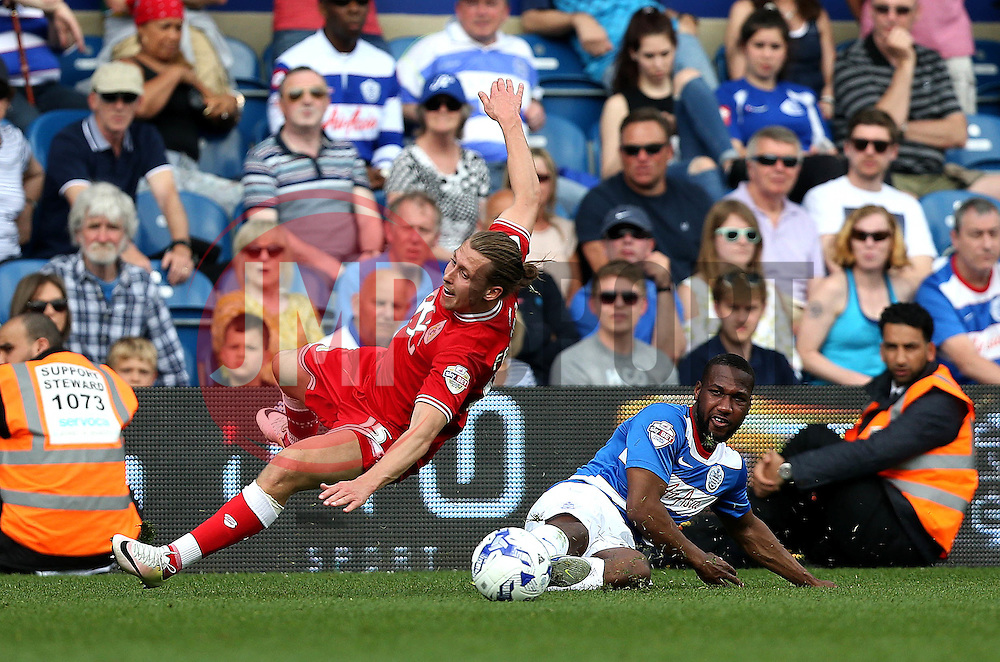 Luke Freeman of Bristol City is fouled by Junior Hoilett of Queens Park Rangers - Mandatory by-line: Robbie Stephenson/JMP - 07/05/2016 - FOOTBALL - Loftus Road - London, England - Queens Park Rangers v Bristol City - Sky Bet Championship