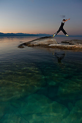 """Boy at Lake Tahoe 5"" - This boy was photographed near Speedboat Beach, Lake Tahoe,  jumping from rock to rock at sunrise."