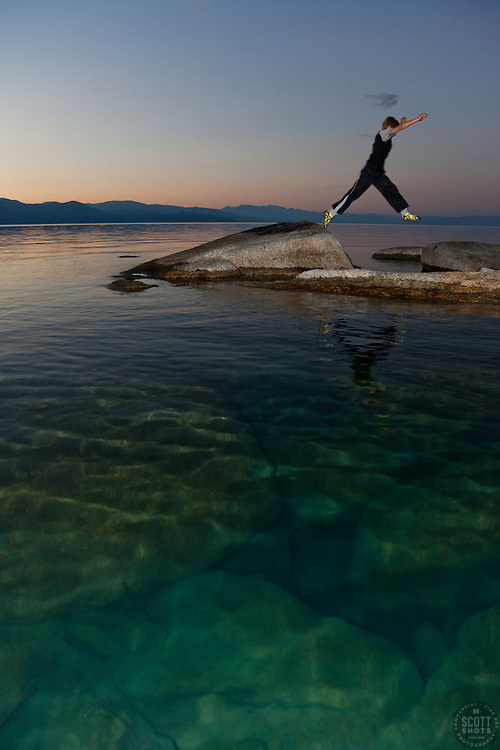 """""""Boy at Lake Tahoe 5"""" - This boy was photographed near Speedboat Beach, Lake Tahoe,  jumping from rock to rock at sunrise."""
