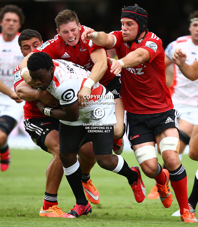 DURBAN, SOUTH AFRICA - APRIL 04:  Lwazi Mvovo of the Cell C Sharks is tackled by Colin Slade and Matt Todd of the Crusaders during the Super Rugby match between Cell C Sharks and Crusaders at Growthpoint Kings Park on April 04, 2015 in Durban, South Africa. (Photo by Steve Haag/Gallo Images)
