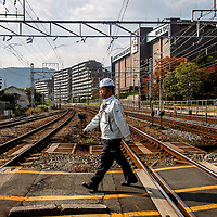 Citizens walk near the Yamazaki Distillery in Yamazaki, Osaka Prefecture, Japan, November 6, 2015. Gary He/DRAMBOX MEDIA LIBRARY
