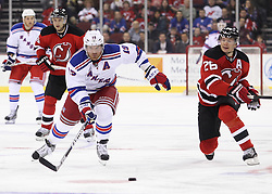 Mar 6; Newark, NJ, USA; New York Rangers center Brad Richards (19) and New Jersey Devils center Patrik Elias (26) race for the loose puck during the first period at the Prudential Center.