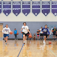 Miyamura Lady Patriots basketball players demonstrate a dribbling drill Wednesday, July 17 at the Miyamura Lady Patriots Basketball Kiddie Camp in Gallup.