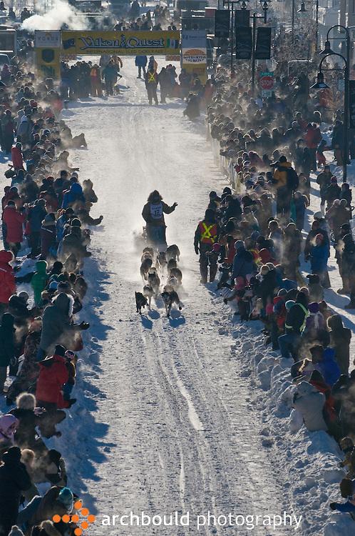 A Yukon Quest dog sled team leaves the start line in Whitehorse en route to Fairbanks, Alaska, 1000 miles away.