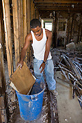 20 SEPTEMBER 2006 - NEW ORLEANS, LOUISIANA: KASS ROBINSON cleans out his home in the Lower 9th Ward of New Orleans, LA. The neighborhood was abandoned after flooding from nearby canals after Hurricane Katrina inundated this part of the city. Robinson said he was evacuated first to Pensacola, FL and then to Atlanta, GA after the storm but that he was going to move back into the Lower 9th Ward. He said the only way the city would come back was if the people who lived there before came back. Photo by Jack Kurtz / ZUMA Press