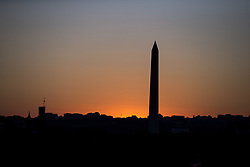 October 3, 2017 - Washington, District Of Columbia, USA - The Sun sets behind the Washington Monument on the National Mall in Washington, D.C. (Credit Image: © Alex Edelman via ZUMA Wire)