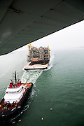 Topside module for the LUCIUS spar being towed offshore from Kiewit in Ingleside, Texas by Crowley Maritime Corporation's OCEAN CLASS Tugs. (Aerial Photography by Tim Burdick)