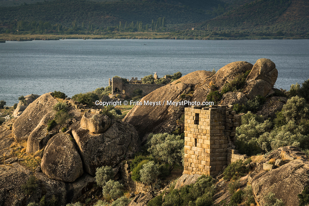 Turkey, October 2015. Hiking between the spectacular boulders of Kapikiri. The Village of Kapikiri better known as ancient Heracleia is one of the highlights on the Carian Trail section from Karahayit via Golyaka to Kapikiri.  Situated roughly between the seaside resorts of Marmaris and Bodrum and the Latmos mountains in the east lies Ancient Caria. The Carian Trail runs through pine scented forests along the coastal mountains of Western Turkey and is littered with ancient ruins, secluded coves with turquoise waters and little villages. more than 800km of ancient roads, shepherd paths and forest trails form Turkey's longest hiking trail. Photo by Frits Meyst / MeystPhoto.com
