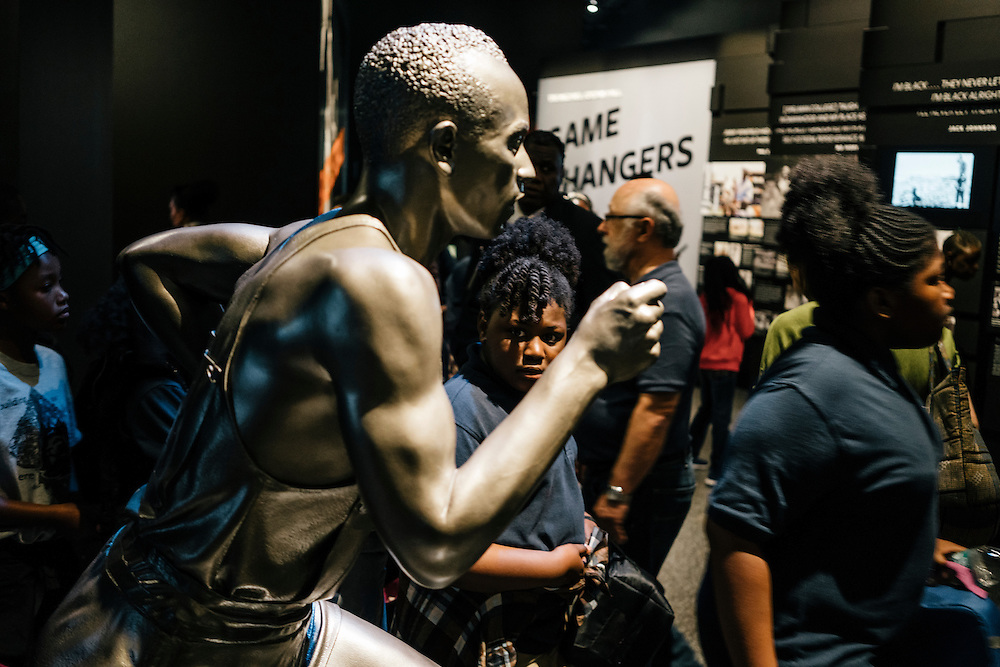 Sixth-graders from Knowledge Is Power Program (KIPP) DC, look at exhibits inside the sports hall of the Smithsonian National Musuem of African American History and Culture during their visit on Oct 21, 2016. The students spent an hour touring the new Washington, D.C. museum, which is only available to see with reserved tickets during the first year.