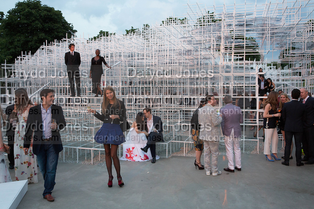 The Serpentine Summer Party 2013 hosted by Julia Peyton-Jones and L'Wren Scott.  Pavion designed by Japanese architect Sou Fujimoto. Serpentine Gallery. 26 June 2013. ,