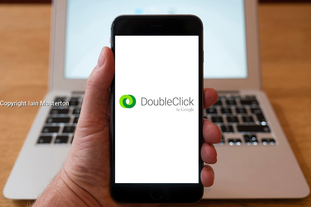 Using iPhone smartphone to display logo of Doubleclick a subsidiary of Google which develops and provides Internet ad serving services
