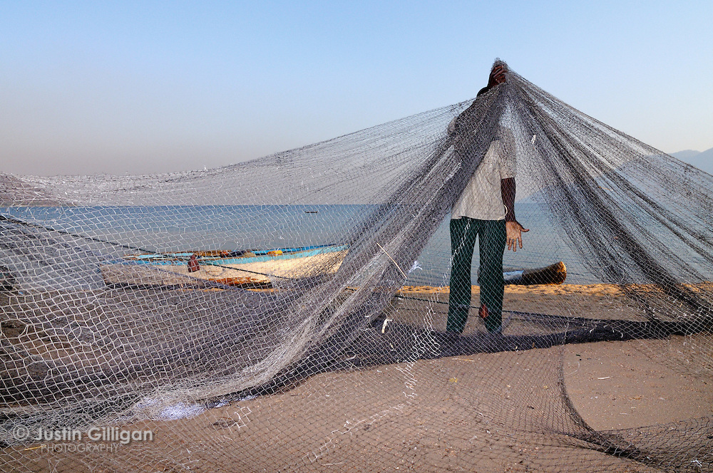 Semi-commercial fishing team prepeares net at Cape Maclear, Lake Malawi, Malawi.