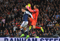 Football - 2016 / 2017 World Cup Qualifier - UEFA Group F: Scotland vs. Slovenia<br /> <br /> Leigh Griffiths of Scotland takes a knee in the back from Jan Oblak of Slovenia during the match at Hampden Park.<br /> <br /> COLORSPORT