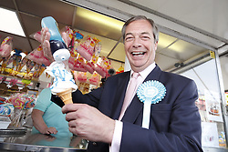 © Licensed to London News Pictures. 18/05/2019. Canvey Island, UK. Brexit Party leader Nigel Farage eats a ice cream as he campaigns for the European Elections in Canvey Island in Essex. The European Elections are being held on Thursday 23rd May. Photo credit: Peter Macdiarmid/LNP