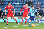 Sam Saunders of Wycombe Wanderers (29) fires in a shot that was saved by Carlisle United goalkeeper Mark Gillespie (1) during the EFL Sky Bet League 2 match between Wycombe Wanderers and Carlisle United at Adams Park, High Wycombe, England on 18 February 2017. Photo by Andy Handley.
