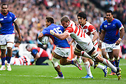 Samoa full back Tim Nanai-Williams is tackled by Japan back row Michael Broadhurst during the Rugby World Cup Pool B match between Samoa and Japan at stadium:mk, Milton Keynes, England on 3 October 2015. Photo by David Charbit.
