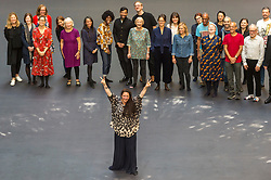 "© Licensed to London News Pictures. 01/10/2018. LONDON, UK. Tania Bruguera (front) stands with volunteers after leaving body impressions on the heat-sensitive floor. Unveiling of the this year's Hyundai Commission by Cuban artist and activist Tania Bruguera at Tate Modern.  The work is called ""an ever-increasing figure"", which represents the scale of mass migration and the risks involved.  Visitors are invited to interact with the work which comprises a heat-sensitive floor, which includes a portrait of a person's face beneath, combined with low frequency sounds.  The work is on display 2 October to 24 February 2019..  Photo credit: Stephen Chung/LNP"