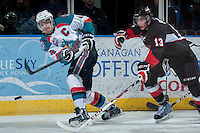 KELOWNA, CANADA -FEBRUARY 25: Zach Pochiro #13 of the Prince George Cougars stick checks Madison Bowey #4 of the Kelowna Rockets as he passes the puck during second period on February 25, 2014 at Prospera Place in Kelowna, British Columbia, Canada.   (Photo by Marissa Baecker/Getty Images)  *** Local Caption *** Zach Pochiro; Madison Bowey;